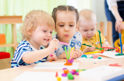 happy kids doing arts and crafts in day care centre